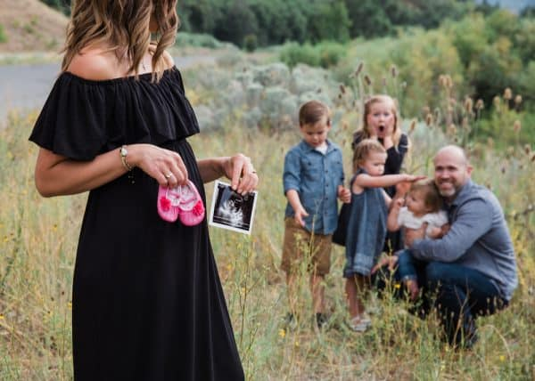 family pregnancy announcement with ultrasound